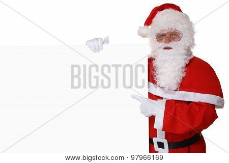 Santa Claus Pointing With Finger On Christmas At Empty Banner