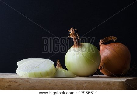 Onions In Preparation On Chopping Board