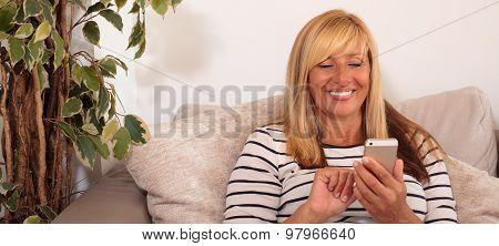 Mature Woman Using A Smartphone