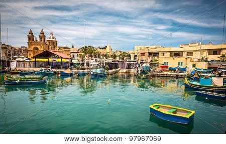 Marsaxlokk, Malta - 24 May 2015: colorful fishing boat in the bay near Marsaxlokk in Malta