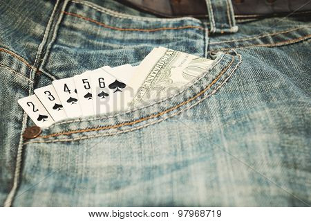 Play card Straight Flush and money in  jean pocket vintage toned