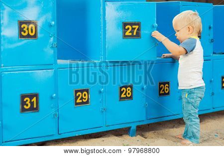 Baby stays near safety boxes