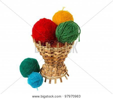 Multi-colored Balls In A Wicker Basket. Isolated On White Background