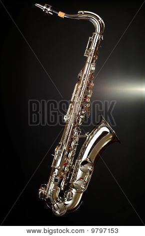 Gold Saxophone On Black Background
