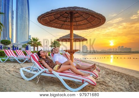 Couple on sun holidays at the Persian Gulf, Abu Dhabi