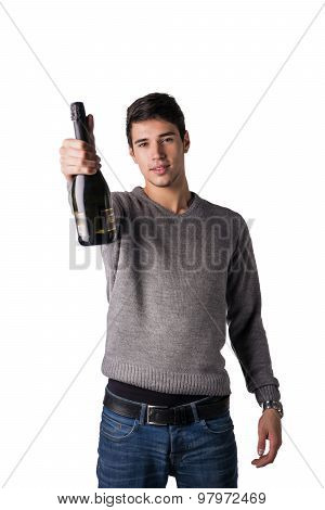Young man holding bottle of champagne or white wine