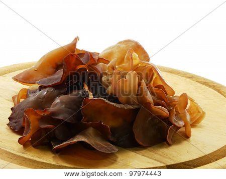 black fungus jelly ear on wooden cutting board