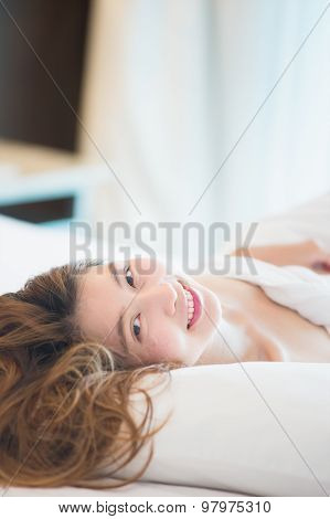 Beautiful Young Woman In White Bathrobe In Bedroom At Home