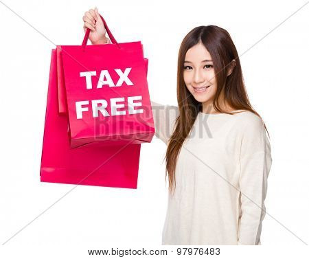 Young Woman hold with shopping bag showing tax free
