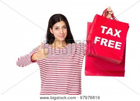 Woman with thumb up gesture and holding shopping bag for showing tax free