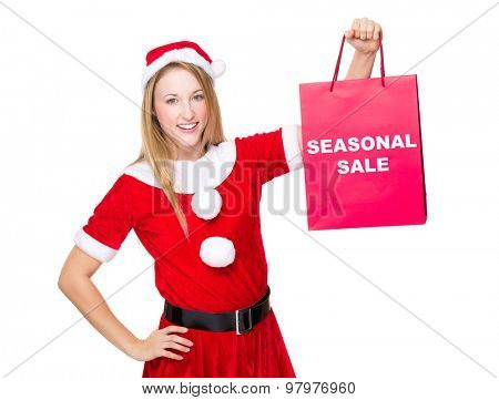 Christmas party dressing girl with shopping bag showing seasonal sale