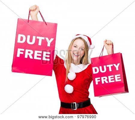 Woman with christmas party dress hold up with shopping bag and showing duty free