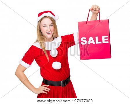 Christmas party dressing girl with shopping bag showing a word sale