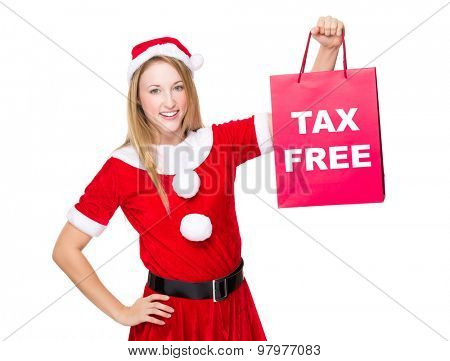 Christmas party dressing girl with shopping bag showing tax free
