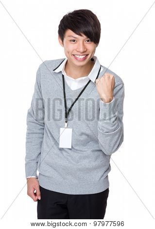 Young businessman with raised arm fist for cheering up