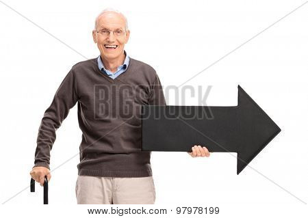 Casual senior with a cane holding a big black arrow pointing right isolated on white background