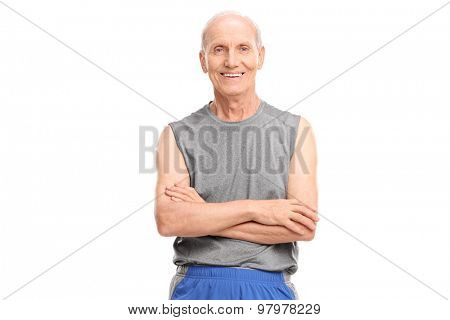 Active senior in sportswear posing with his arms crossed and looking at the camera isolated on white background