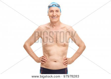 Shirtless senior in black swim trunks and blue swimming cap looking at the camera and smiling isolated on white background