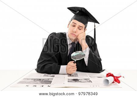 Graduate student searching for job in the papers isolated on white background. The newspaper is custom made, text is Latin and the pictures are my copyright. Additionally property release uploaded.