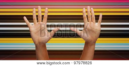 gesture, people and body parts concept - african woman two hands showing palms or making high five over blue sky and clouds background