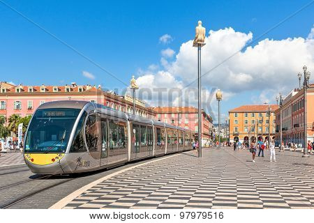 NICE, FRANCE - AUGUST 23, 2014: Tramway passing on Place Massena - one of the main city squares, place for carnivals, concerts, parades, traditional celebrations and other public events.