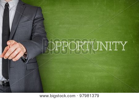 Opportunity on blackboard with businessman