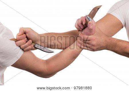 Blocking arms with a knife.
