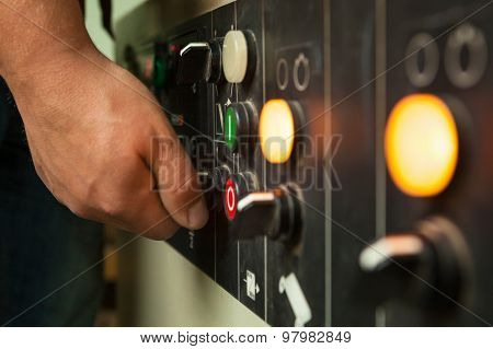 Male Hand Operating Switches And Buttons.