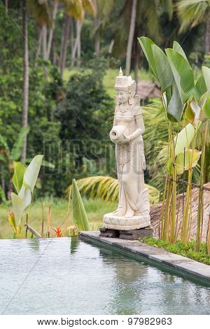 Traditional Balinese Stone Sculpture In Swimming Pool . Island Bali, Ubud, Indonesia