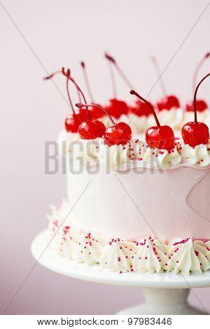 Cake decorated with maraschino cherries