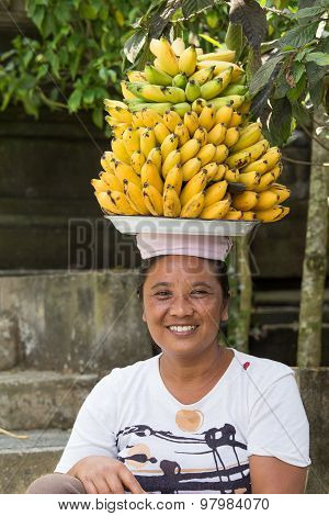 Portrait of unidentified woman together with bananas