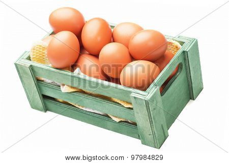 Raw chicken eggs in crate, isolated on white background
