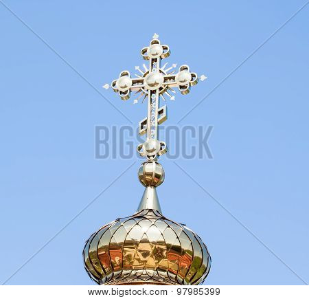 Golden dome with a cross of the Church