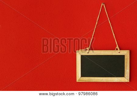 chalkboard hanging on red wall