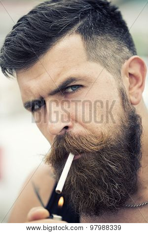 Smoking Unshaven Man