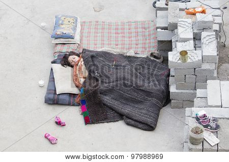 Indian Girl Sleeping On The Street Next To Monastery Of Lamayuru, Ladakh, India