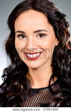 Portrait of young woman with a beautiful smile and healthy teeth. Teeth braces. Studio shot.
