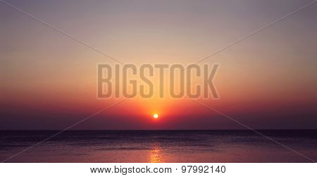 Scenic Landscape View Of The Sea With A Beautiful Evening Sunset, The Sun Sets Beyond The Horizon, T