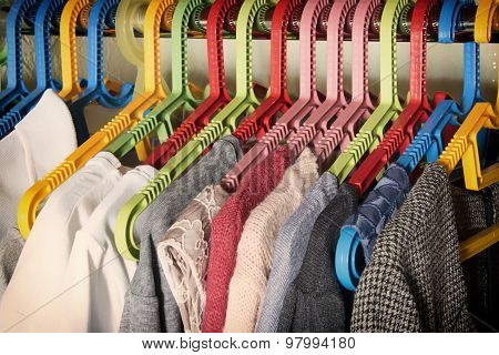 Colorful Clothes On Hangers In The Wardrobe