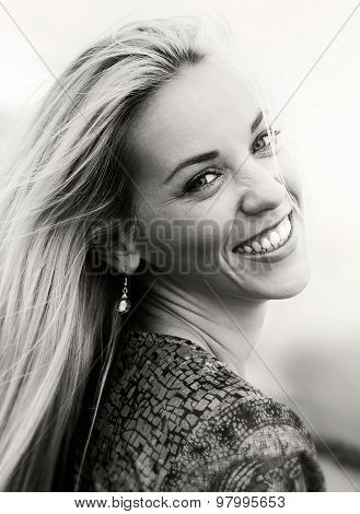 Happy Smiling Young Woman With Wind Into The Hair