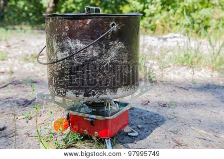 Small Camping Gas Stove And  Large Smoky Pot.