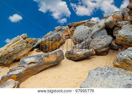 Stone Desert On  Blue Sky And White Clouds Background.