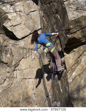 Brunette female climber on the wall