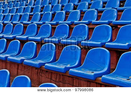 Blue Plastic Chairs On A Football Tribune