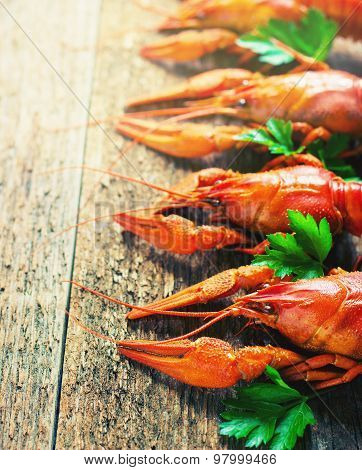 Boiled Crayfish On A Wooden Background.