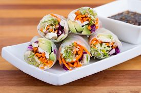 foto of soy sauce  - colourful chicken sprouts and avocado rice paper spring rolls with soy base dip sauce - JPG