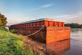 picture of barge  - red and rusty barge with a cover at a shore of Missouri River near Hermann - JPG