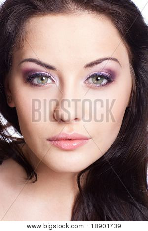 closeup portrait of beautiful young adult with makeup