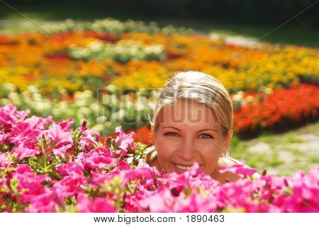 The Woman Is Hidden Behind Flowers