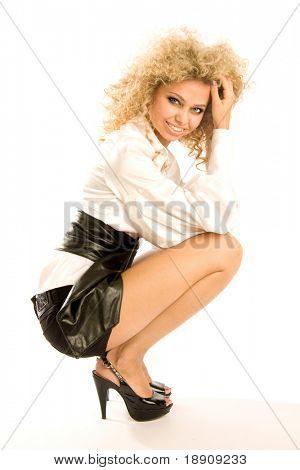 Schönes Blondes Fotomodell isoliert auf weißem Hintergrund